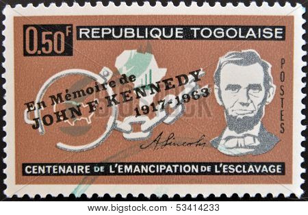 A stamp printed by Togo shows Lincoln Broken Fetters Maps of Africa and US emancipation from slavery