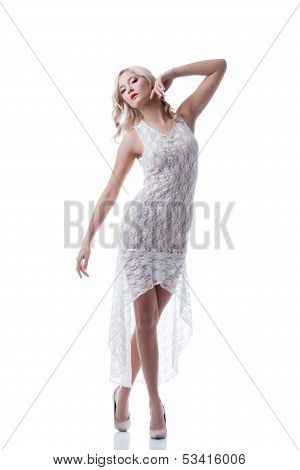 Charming young blonde posing in erotic dress