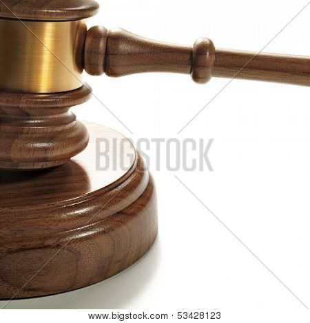 A wooden gavel and soundboard