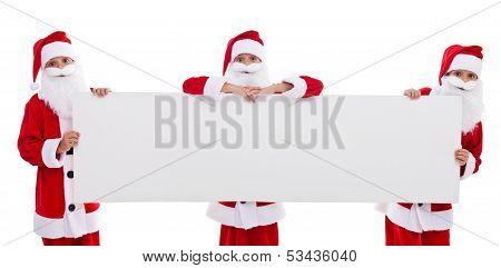 Happy Santas Holding Blank Banner