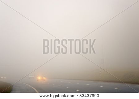 Road and a car in fog