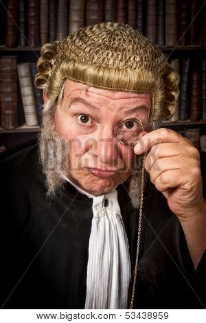 Vintage judge looking through a monocle in court