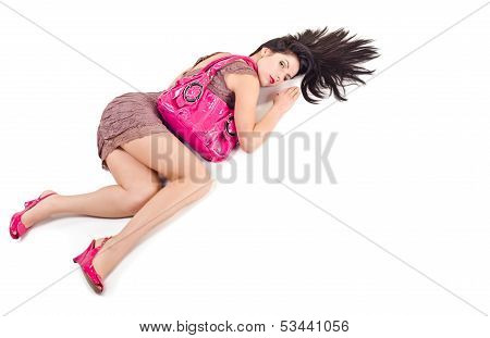 Woman lying holds on shoulder bag