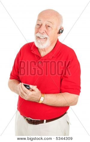 Senior Man With Hands Free Set