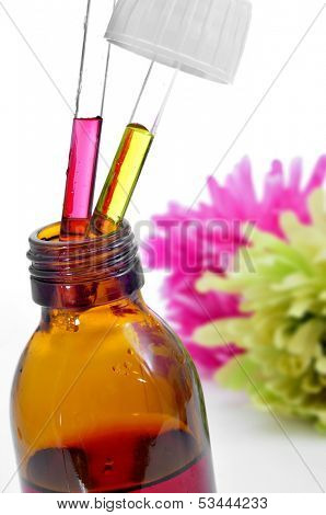 closeup of a dropper bottle with Bach flower remedies, on a white background