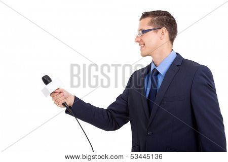 side view of journalist interviewing with microphone on white background