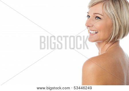 Smiling Nude Woman Looking Away
