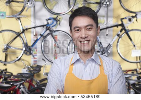 Portrait of young male mechanic in bicycle store