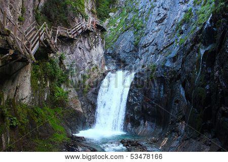 Cliffside Steps Near Waterfall