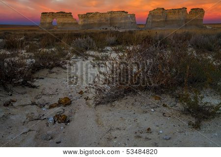 Sunset View Of Monument Rocks In Kansas