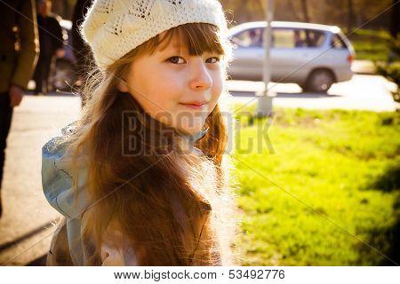 Little Girl In Park In The Autumn