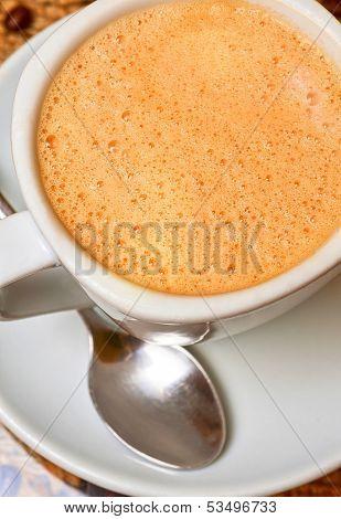 cup of cappuccino coffe closeup