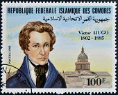 FEDERAL ISLAMIC REPUBLIC COMOROS - CIRCA 1985: A stamp printed in Comoros shows Victor Hugo