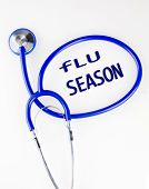picture of flu shot  - Flu season text inside a blue stethoscope on a white background - JPG