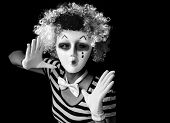 stock photo of mime  - Scary mime wearing mask and clown wig