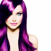 Beautiful Girl with Healthy Long Purple Hair and Blue Eyes. Beauty Model Woman with Professional Mak