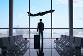 stock photo of tile  - man in airport and airplane in sky - JPG