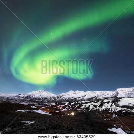Northern lights above fjords in Iceland
