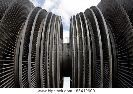 Steam Turbine Of Nuclear Power Plant Against Sky And Clouds