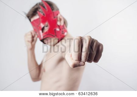 Fighter posing with mexican mask
