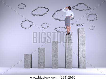 Businesswoman scratching her head on bar chart depicting growth