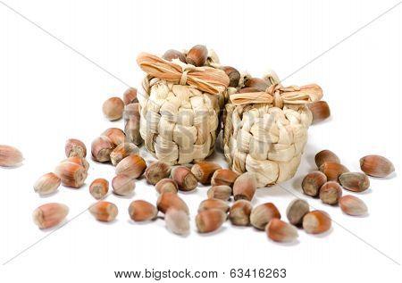 Strawy sandals with  handful of hazelnuts around