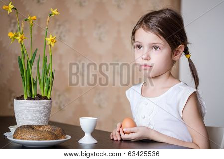 Small girl holding Easter egg in her hands