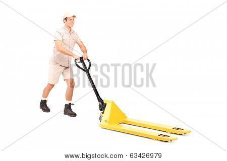 Male worker pushing a fork pallet truck isolated on white background