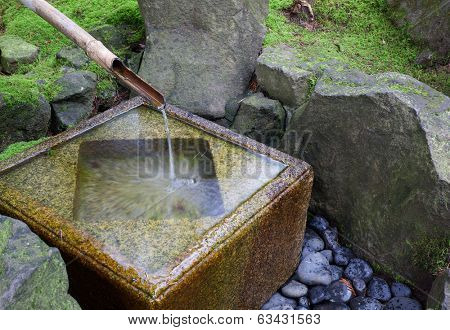 Slow shutter shot of Japanese water fountain