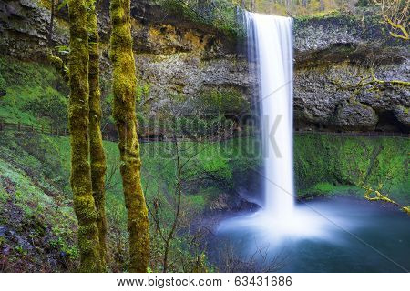 South Falls at Silver Falls Park in Oregon with water falling into a pond done with slow exposure