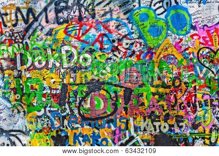 PRAGUE, CZECH REPUBLIC - APRIL 28, 2012: Lennon Wall  is filled with John Lennon-inspired graffiti and pieces of lyrics from Beatles songs