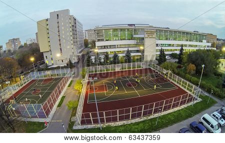 MOSCOW - OCT 11: View from unmanned quadrocopter to people plays on basketball playground in front the Moscow State Technical University on October 11, 2013 in Moscow, Russia.