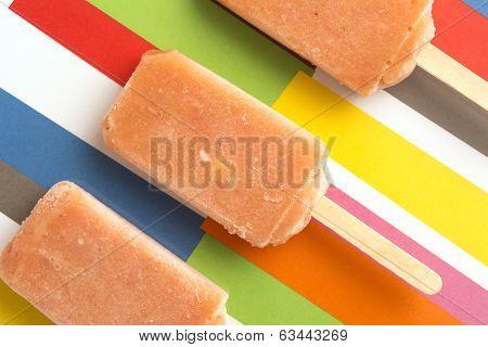Strawberry, Orange, Pineapple, Mango Fruit Popsicles On Colorful