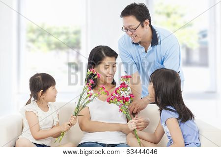 Daughters And Father Celebrating Mother's Day