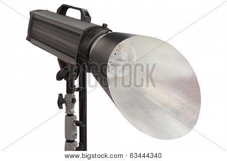 studio monoblock flash light on tripod isolated under the  white background
