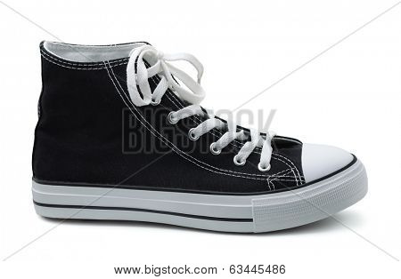 Single canvas sneaker isolated on white