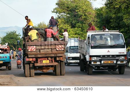 African Men Make Trip Back Of A Truck.