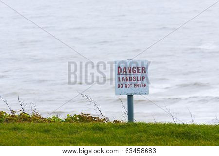 Danger Sign For Public Information Sign Next To Sea Cliff