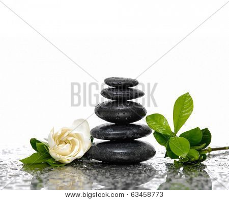 Spa Background with gardenia flowers and stacked stones