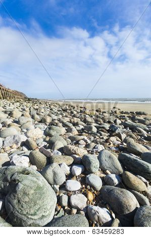 Portrait Format Wide Angle Pebble Beach And Blue Sky