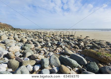 Landscape Format Wide Angle Pebble Beach And Blue Sky