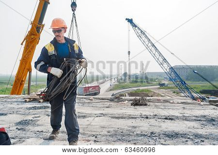 Worker on construction of bridge