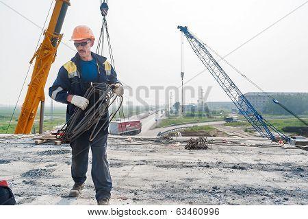 Worker on construction of bridge