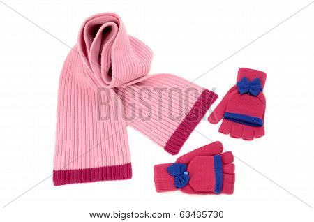 Cute pink winter scarf and a pair of gloves nicely arranged.