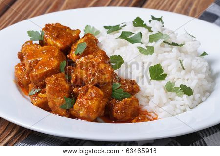 Tasty Fillet Chicken Curry With Rice On A Plate
