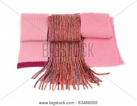 Three cute pink winter scarves nicely arranged.