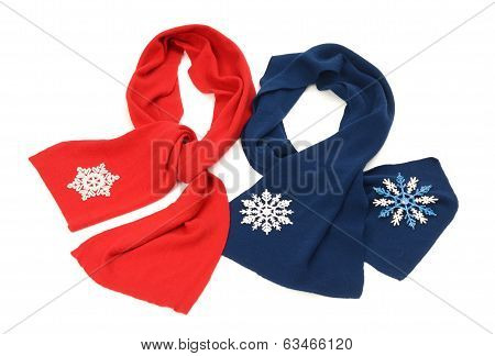 Red and dark blue scarf decorated with snowflakes.