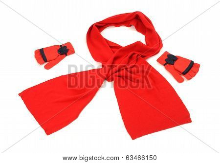 Red wool scarf, a pair of gloves nicely arranged.