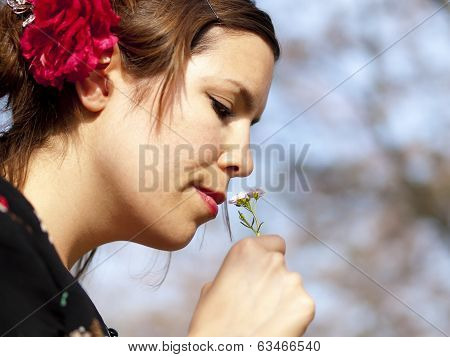 Beautiful Girl Smelling A Cuckoo Flower In The Spring