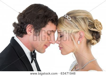 Side view close-up of newlywed couple head to head on white background